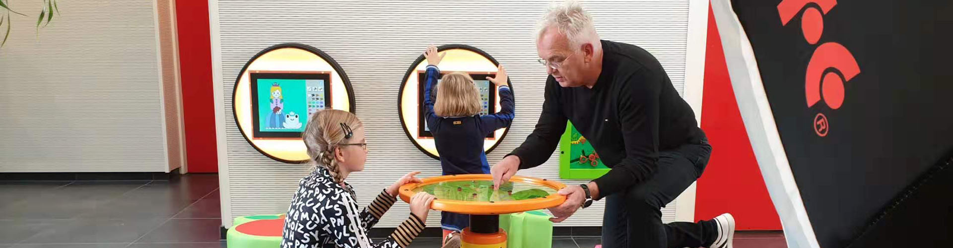 this image shows kids with a playcorner and Marco Lankman, CEO