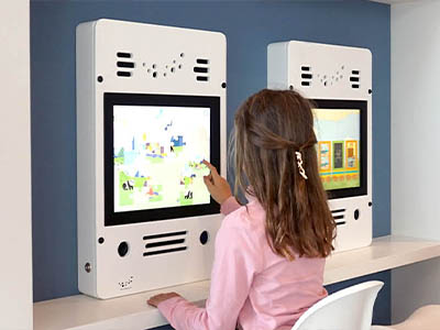 this image shows a kids corner with interactive play system in a town hall